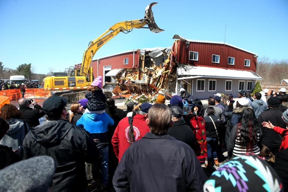 Cedric Cromwell, chairman of the Mashpee Wampanoag Tribal Nation demolished one of the first buildings ona prospective casino site in Taunton in April 2016.